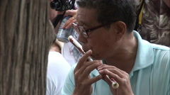Chinese musician playing dizi flute in park Arkistovideo