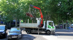 Maintenance worker loads bench in a truck at the park in Madrid, Spain Stock Footage