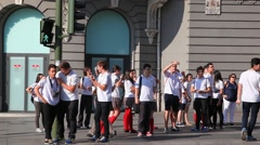 Group of students from high school cheers friends on the street of Madrid, Spain - stock footage