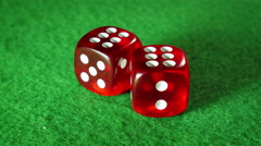 Red dices on the green cloth background. Rotation. Double six. Stock Footage