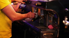 The barman at the bar counter prepares coffee using the coffee machine Stock Footage