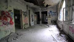 Slow motion of walking through abandoned building with graffiti - stock footage