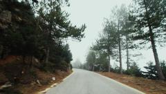 Pov drive mountain road winter fog overcast Stock Footage