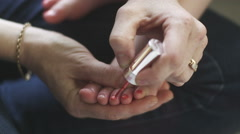 Little Girls Toenails Being Painted By Mum Stock Footage