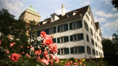 Roses to Big Swiss House Rack Focus Stock Footage