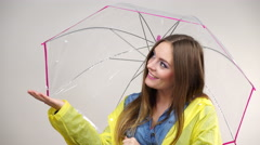 Woman in rainproof coat with umbrella. Forecasting 4K - stock footage
