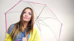 Woman wearing rainproof coat holding umbrella 4K Stock Footage