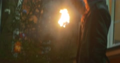 Man is Putting Out a Fire Blowing on a Torch Cannot Put it Out Dance Troupe is - stock footage