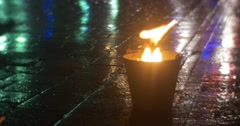 Fire in a Bucket Fire Tongues Are Raising Up Dancers are Walking along a Fire - stock footage