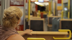 Woman Rides Light Rail at Night Stock Footage