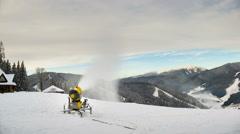Snow machine gun on a ski slope. Timelapse Stock Footage