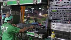 Soundman at work for a thai band,Bangkok,Loi Krathong,Thailand Stock Footage
