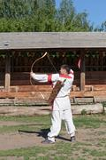 Russian man in national dress archery - stock photo