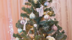 New Year's toys on the Christmas tree tilt-up Stock Footage