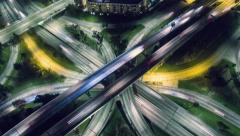 Vertical aerial view traffic on freeway interchange at night. 4K UHD timelapse - stock footage