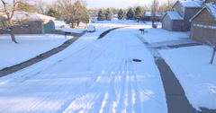 Aerial view of residential neighborhood covered in snow. Stock Footage