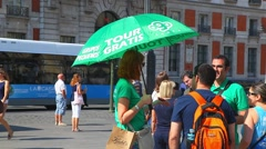 Tourist guides at town sguare waiting for the people group in Madrid, Spain Stock Footage