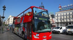Tourist buses cross Puerta Del Sol Square in Madrid, Spain Stock Footage