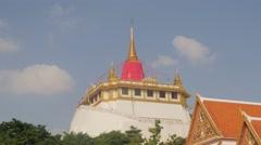 The golden mount hilltop temple at Wat Saket,Bangkok,Thailand Stock Footage
