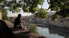 Man Overlooking Zurich from Lindenhof Stock Footage