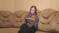 Women using ipad digital tablet for social network in room Stock Footage