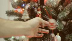 Man's hand shakes Christmas toys. Stock Footage