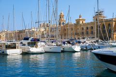 Stock Photo of The yachts moored in the harbor in front of Malta Maritime Museum. Malta.