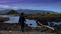 Woman On Wilderness Beach Stock Footage
