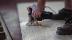 Circular saw cutting angle in plywood - stock footage