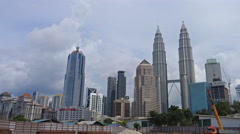 The Petronas Twin Towers and the city of Kuala Lumpur on a cloudy day Stock Footage