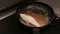 Breaded haddock being fried in a pan Stock Footage
