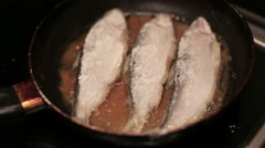 Fish is being fried on the frying pan. Close Up Stock Footage