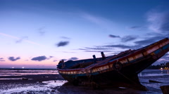 Sunrise with Boat on Tide Flats - stock footage