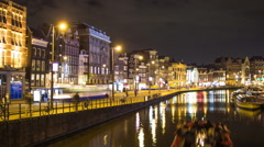 Time lapse of a canal in Amsterdam in the night Stock Footage