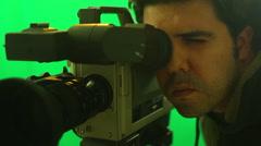 camera man looking through viewfinder look filming - stock footage