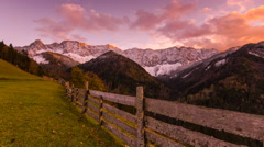 Time lapse - Sunset with a fence and a mountain in autumn - stock footage