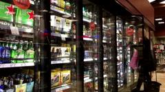 People choosing wine inside BC liquor store on Christmas eve date - stock footage