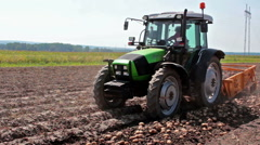 Tractor and potato digger Stock Footage