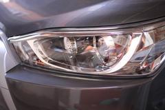 Closeup of car headlight background - stock photo