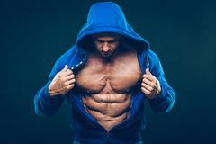 Man with muscular torso. Strong Athletic Men Fitness Model Torso showing six - stock photo
