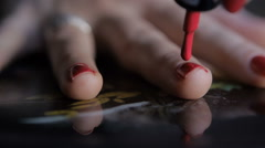Girl applying nail polish Stock Footage