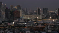 Skyscrapers and traffic in evening,Bangkok,Thailand Stock Footage