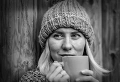 Beautiful blonde female drink coffee uoutdoor Stock Photos