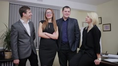 Group of happy businesspeople standing in a row Stock Footage