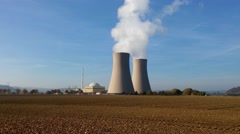 Nuclear power plant on the sky background in sunlight Stock Footage