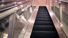 Movement of lifting on modern shiny escalator in building Stock Footage