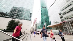 Walking people and Bank of America Tower at One Bryant Park Stock Footage