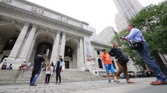 Tourists and New york public library in NYC, United States Stock Footage