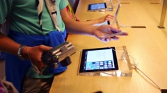 IPads in hands of buyers in store in NYC, United States Stock Footage