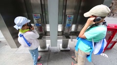 Happy sister and brother talking on street phones in New York city Stock Footage